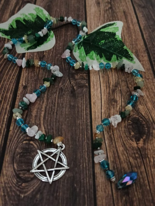 This prayer bead can be used on your altar, or as a focus for your meditations for the spring equinox, Ostara. Each crystal is specific to the sabbat.