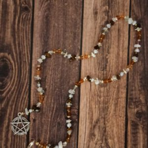 Prayer bead for the midsummer sabbat, Litha. Using corresponding colors and stones. This can used on your altar or in meditation. Made with flourite, pearl, moonstone, and tiger's eye.