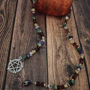 Prayer bead for the fall equinox, Mabon, using the corresponding colors and stones. This can be used on your altar, or in your meditation. Made with aventurine, amethyst, clear quartz, and citrine.